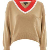 Béžový svetr s červeným výstřihem do V